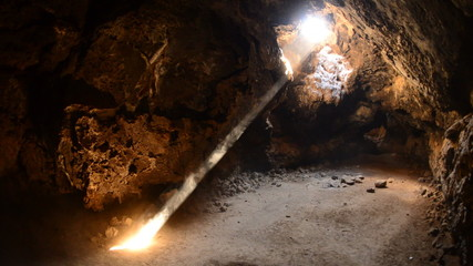 Light Rays Shine inside of Lava Tube Cave