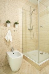Interior of beige bathroom