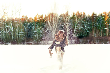 Winter enjoyment. Glad girl having fun in forest. Filtered image