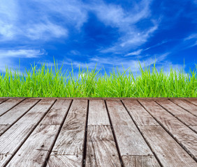 Old wood decking with blue sky