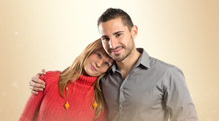 Happy couple over isolated white background