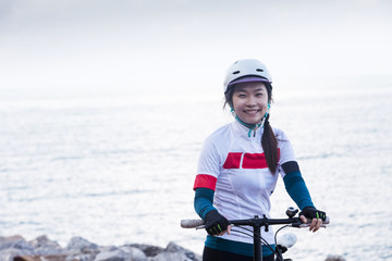 Cycling - Biker girl at seaside