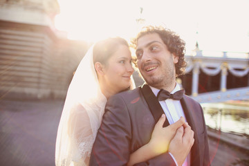 Close up of a bride and groom in the sunlight