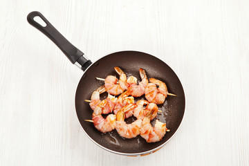 cooking prawns wrapped in bacon