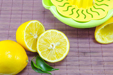 Whole and halved lemons and a squeezer
