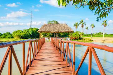 Wooden bridge on a beautiful lake, Vinales, Cuba