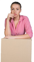 Woman leaning on cardboard box