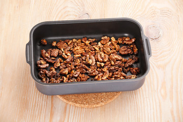 roasting walnuts in baking dish