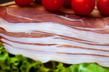 Bacon with cherry tomato and leaf of green salad
