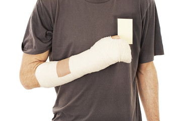 Man's arm in cast holding a blank card