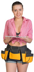 Woman in tool belt holding tablet PC on her palms
