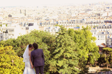 Bride and groom kissing in Paris, France