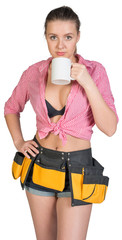 Woman in tool belt holding mug