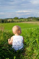 beautiful happy boy playing in grass