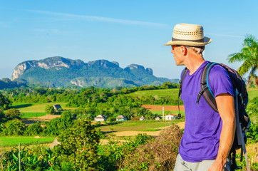 Young hiker admires the beautiful landscape in Vinales, Cuba