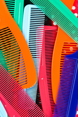 assortment of colorful hair combs