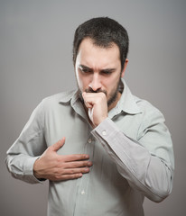 Strongly coughing young man suffered from asthma