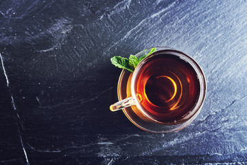 top down photo of a glass of tea on slate