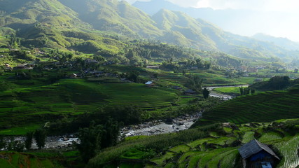 Zoom Out - Time Lapse of Clouds and Shadows Passing over a Valley of Rice Terraces in Sapa Vietnam
