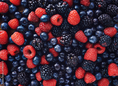 blueberies, raspberries and black berries shot top down © Joshua Resnick