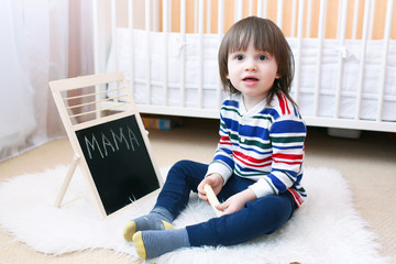 Lovely 2 years boy learns to writing words