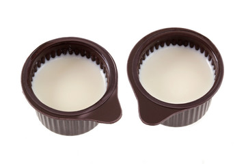 Two small cup of Coffee Creamer isolated on white