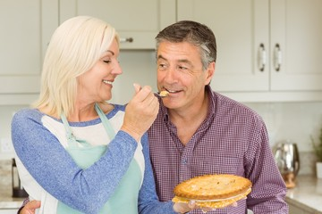 Happy mature blonde feeding pie to husband