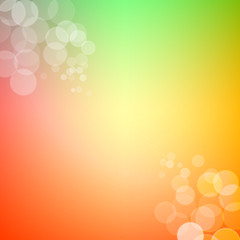 Abstract bokeh sparkles on spring themed blurred background