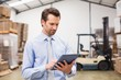 canvas print picture - Manager using digital tablet in warehouse