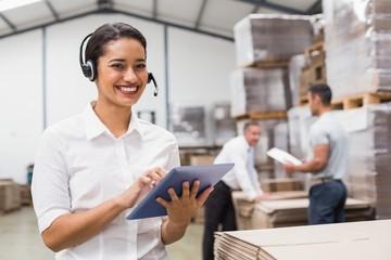 Female manager using digital tablet