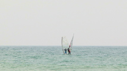 Windsurfers Meet In the Sea