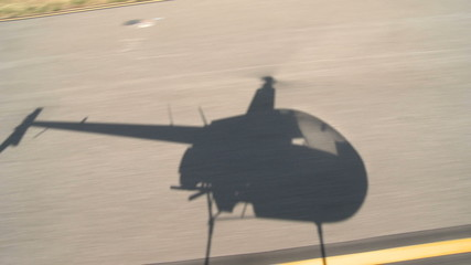 Shadow of Helicopter talking off.