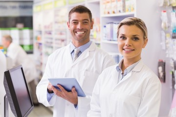 Team of pharmacists looking at camera