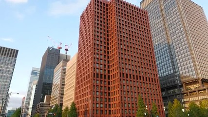 Pan Down of Building to Traffic in Central Tokyo Japan