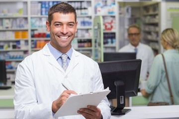 Happy pharmacist looking at camera