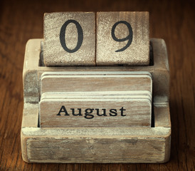 A very old wooden vintage calendar showing the date 9th August o