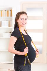 Pregnant woman exercising at home