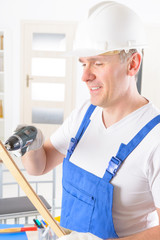 Man with wireless electric drill