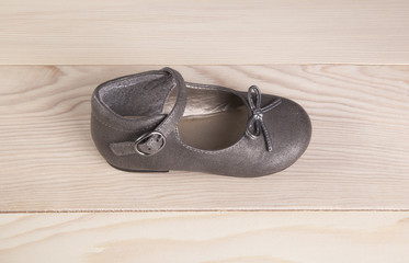 baby shoes on wood background