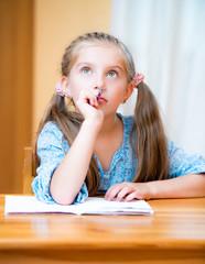 Cute little girl studying