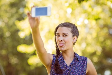 Pretty hipster taking a selfie