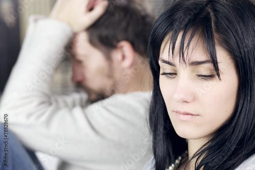 Sad woman not looking upset husband - 78828670