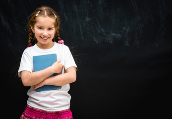 little girl  on black school board background