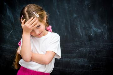 little girl on the background of school board