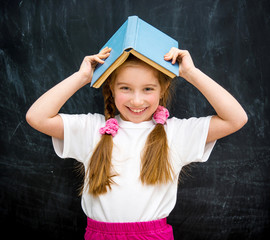 little girl with a blue book