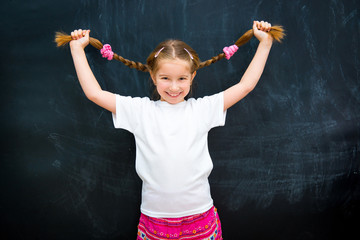 girl in a white T-shirt lifted pigtails