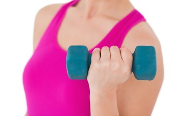 Fit woman with blue dumbbell