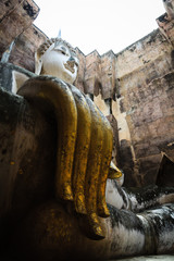 The main Buddha statue in the temple of Sukhothai, Thailand