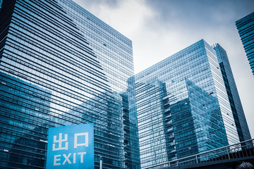 glass building with garage exit traffic sign