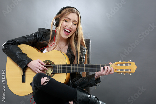 a beautiful young blonde with a classical guitar - 78829840